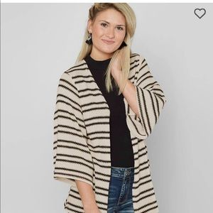 Cardigan from Buckle. Fits like a medium